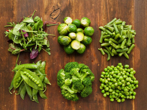 Different kinds of vegetables on the wooden background. Viewed from above.